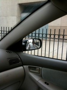 Cop on horseback in sideview mirror